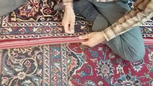 لفافه دوزی ریشه های فرش دستباف