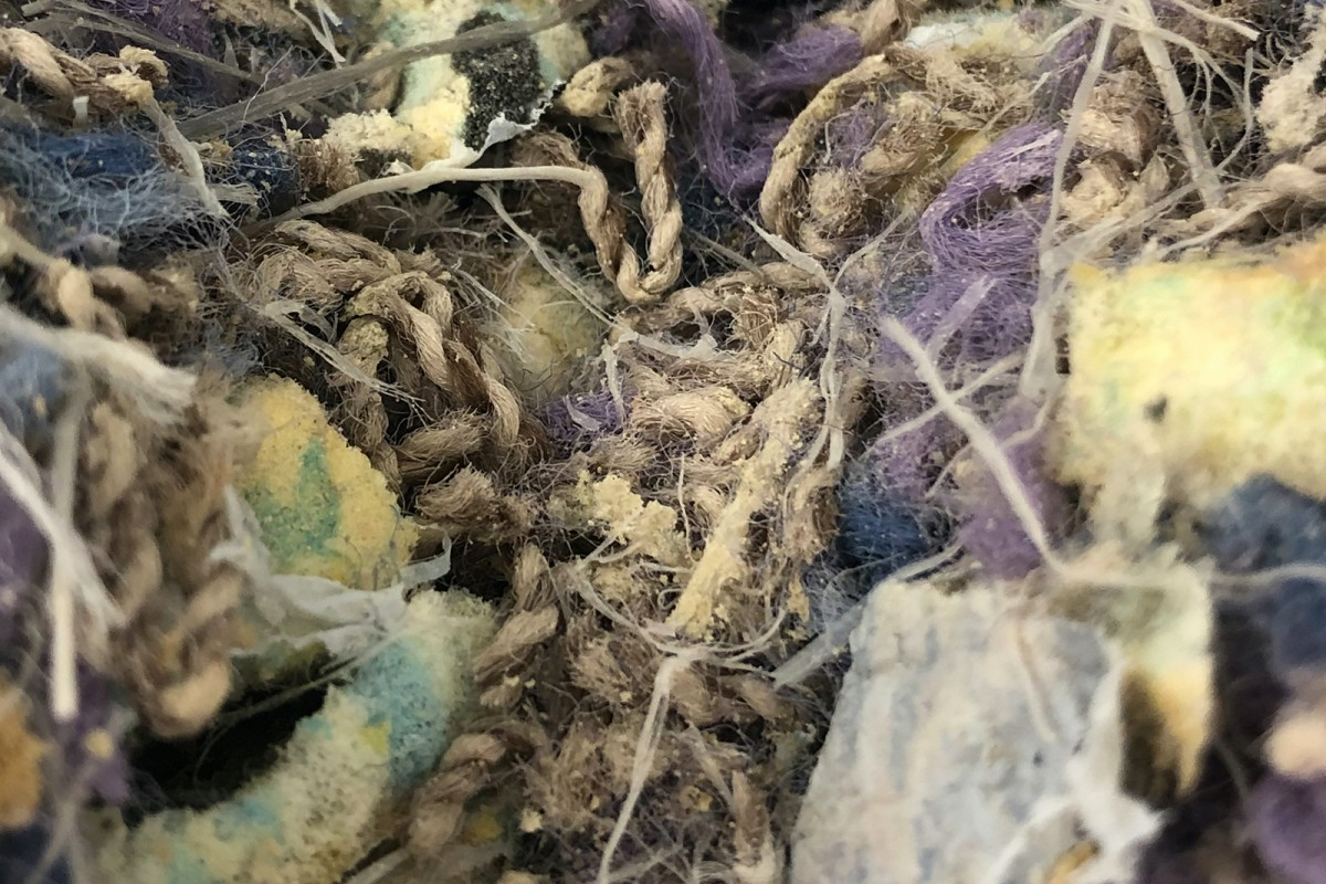Cleaned and shredded carpet waste, prior to the solvent treatment